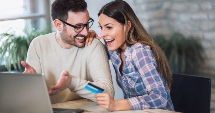 man-woman-card-laptop-buy-online-shopping
