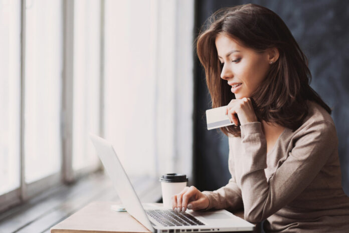 woman-online-shopping-credit-card-1068x713